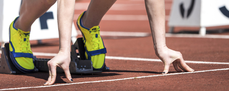 sports training: sprint start in track and field Stock Photo