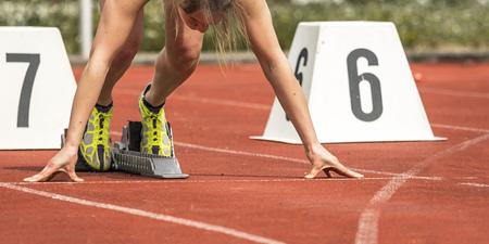 sportsmen: sprint start in track and field Stock Photo