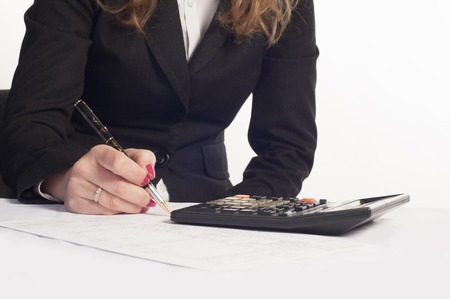 tec: Business woman writing on a document Stock Photo