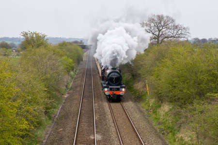 A steam train on the track photo