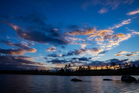 treeline: beautiful fall sunset, with a colorful cloudy sky Stock Photo