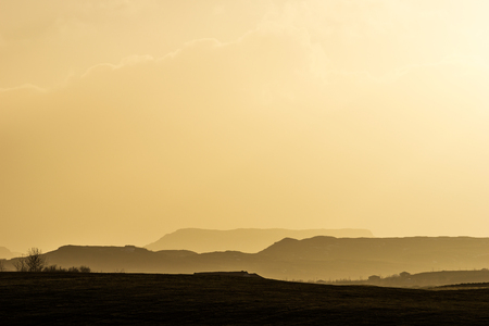 soft peak: Mountain landscape bathing in golden late afternoon light in southern Iceland