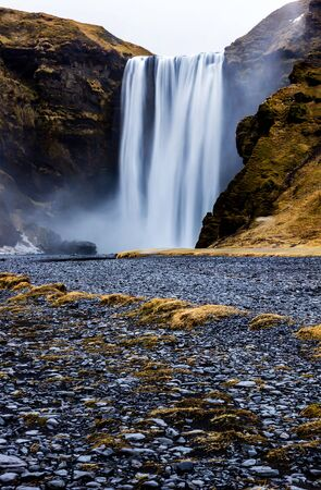 skogafoss waterfall: Skogafoss Waterfall, southern part of Iceland, at overcast weather Stock Photo