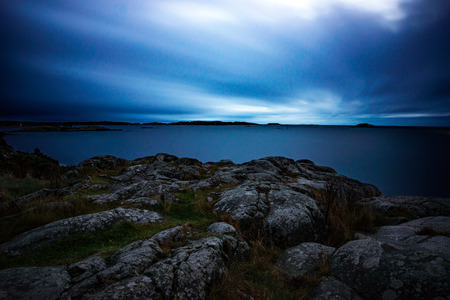 blue sea: View from cliff by the baltic sea archipelago in dusk. Longe exposure Stock Photo