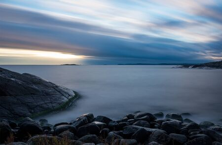 archipelago: View over the baltic sea archipelago in the sunset, with rocks in the foreground. LONGE EXPOSURE Stock Photo
