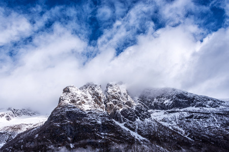 Mountain Top under blue sky with white clouds