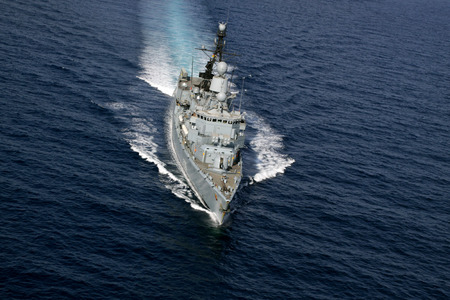 headway: aerial photography of a warship at sea