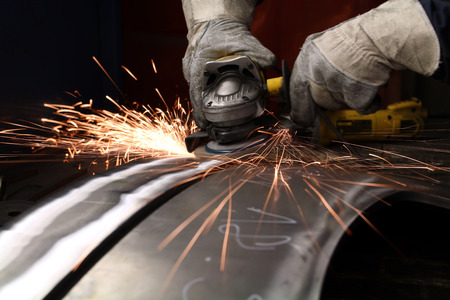 burnish: grinding machine throwes out sparks