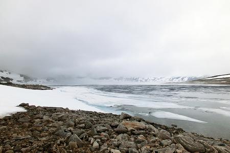mood moody: Ice Lake in the summer Vermevatnet, Norway Stock Photo