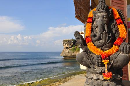 god figure: Traditional Balinese God statue, at Ocean in Balangan, Bali, Indonesia.