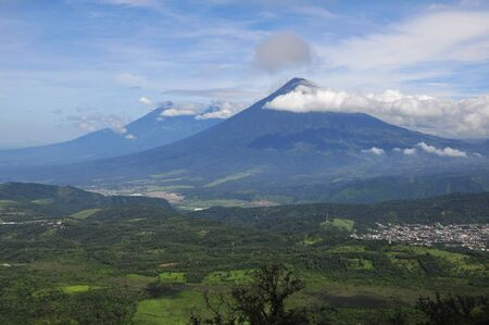 View of volcan de agua from active volcano Pacaya near Antigua in Guatemala, Central America.