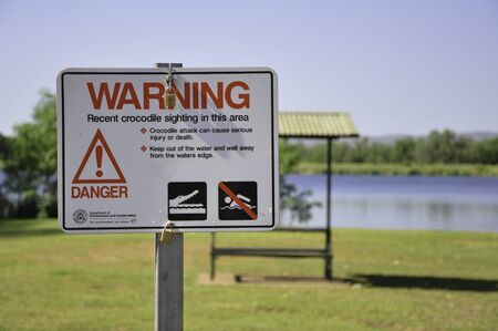 Kununurra, Australia - November 9, 2010. Crocodile warning sign for recent crocodile sighting in this area. Picture taken near Kununurra, Western Australia, Australia.