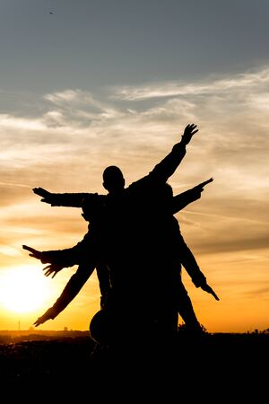 zest for life: People silhouette family has fun in the sunset