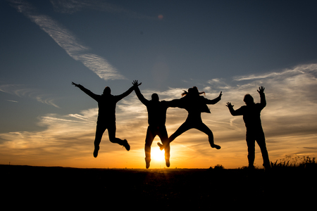 zest for life: People silhouette Family jumping together in the sunset