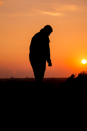 lebensfreude: People Silhouette Sad Sad Man man in the sunset Lizenzfreie Bilder
