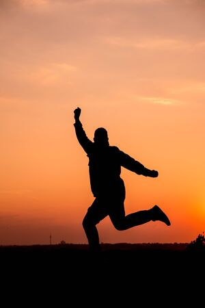 lebensfreude: People silhouette man jumping in the sunset
