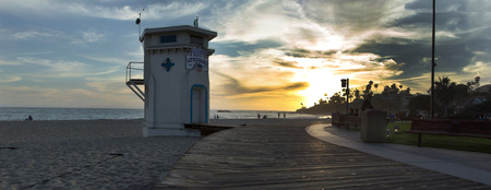 Panoramic view of the boardwalk at Main beach in Laguna Beach Southern California at sunset