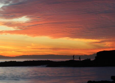 southern california: Sunset over the ocean and rock jetty at Shaws Cove in Laguna Beach Southern California