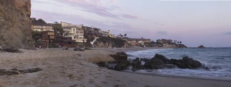 southern california: The sunset over the beach homes at Victoria Beach in Laguna Beach, Southern California