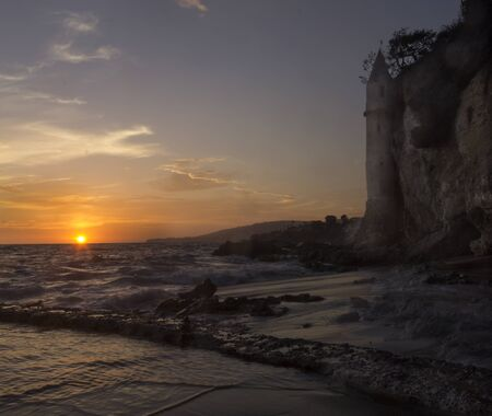 southern california: The sunset over the turret tower at Victoria Beach in Laguna Beach, Southern California Stock Photo