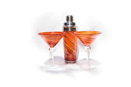 blown: Orange martini cocktail blown glasses and a shaker on a white background Stock Photo