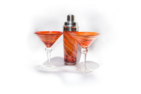 martini shaker: Orange martini cocktail blown glasses and a shaker on a white background Stock Photo