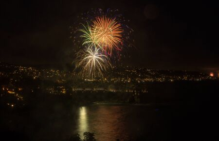 new years vacation: Laguna Beach fireworks  city lights on the fourth of July celebration Stock Photo