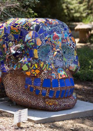 garcia: Editorial- Mosaic skull, La Dentuda by Margaret Garcia at Los Angeles County Arboretum under the San Garbriel Mountains. Stock Photo