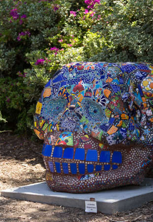 los angeles county: Editorial- Mosaic skull, La Dentuda by Margaret Garcia at Los Angeles County Arboretum under the San Garbriel Mountains. Stock Photo