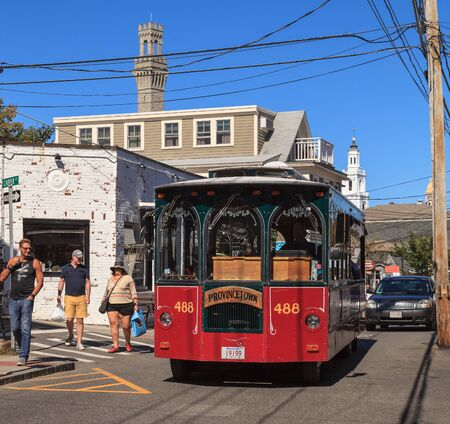 cape cod style: Provincetown, Massachusetts  September 23, 2015: Trolley car gives a tour in Provincetown on Cape Cod. Editorial Use Only.