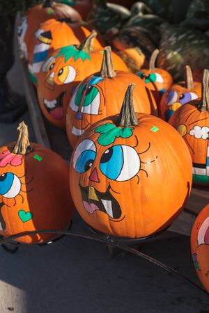 funny faces: Provincetown, Massachusetts  September 23, 2015: Halloween pumpkins with funny faces drawn on them