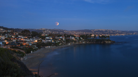 lunar eclipse: September 27, 2015. Laguna Beach, California Crescent Bay view of the blood moon. This full moon, also called a super moon and a harvest moon, is the result of a lunar eclipse.