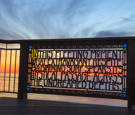 browns: Stained glass fence at Browns Park in Laguna Beach, California at sunset