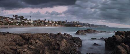 beach rain: Rain clouds over Crescent Bay in the fall in Laguna Beach, California, United States