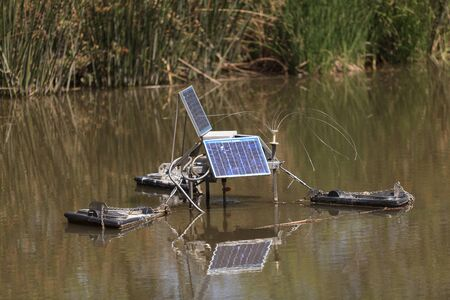 monitoring system: Solar powered water monitoring system set up in a pond at the San Joaquin wildlife reserve marsh in Irvine, California, United States.