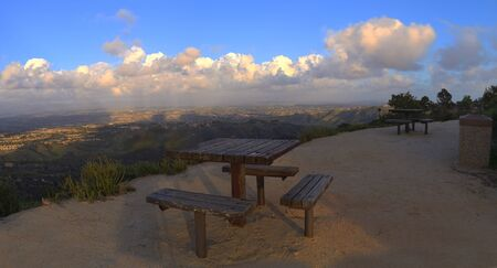top of the world: Panoramic view before sunset from the top of the hiking trail at Alta Laguna Park, Top of the World, overlooking the picnic benches and saddleback mountains in Laguna Beach, Southern California