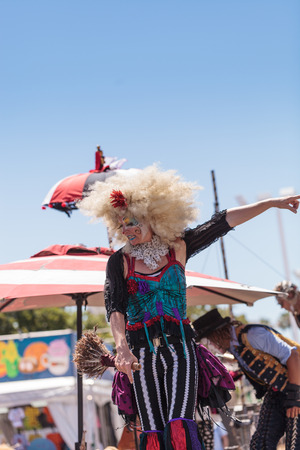 oc: Costa Mesa, California, United States - July 16, 2016: Theatrical circus performer Megan Fontaine, part Mango and Dango, performs with Dragon Knights steampunk stilt walkers at the Orange County Fair in Costa Mesa, CA on July 16, 2016. Editorial use only.