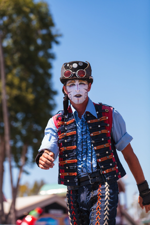 county fair: Costa Mesa, California, United States - July 16, 2016: Performer Benjamin Gadbois with the Dragon Knights steampunk stilt walkers at the Orange County Fair in Costa Mesa, CA on July 16, 2016. Editorial use only.