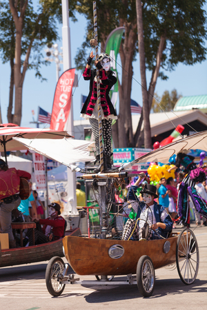 oc: Costa Mesa, California, United States - July 16, 2016: Dragon Knights steampunk stilt walkers perform at the Orange County Fair in Costa Mesa, CA on July 16, 2016. Editorial use only.