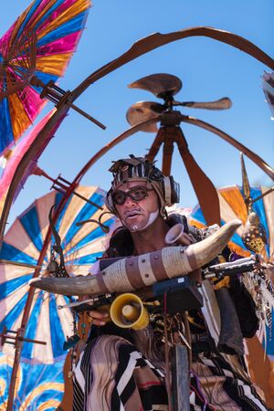 16: Costa Mesa, California, United States - July 16, 2016: Theatrical circus performer Derrick Gilday, part Mango and Dango, performs with Dragon Knights steampunk stilt walkers at the Orange County Fair in Costa Mesa, CA on July 16, 2016. Editorial use only.