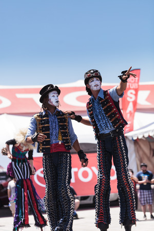 county fair: Costa Mesa, California, United States - July 16, 2016: Dragon Knights steampunk stilt walkers perform at the Orange County Fair in Costa Mesa, CA on July 16, 2016. Editorial use only.