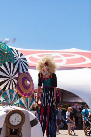 mesa: Costa Mesa, California, United States - July 16, 2016: Theatrical circus performer Megan Fontaine, part Mango and Dango, performs with Dragon Knights steampunk stilt walkers at the Orange County Fair in Costa Mesa, CA on July 16, 2016. Editorial use only.