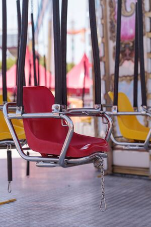 fairground: Colorful swing carousel carnival chair ride on a fairground in summer.