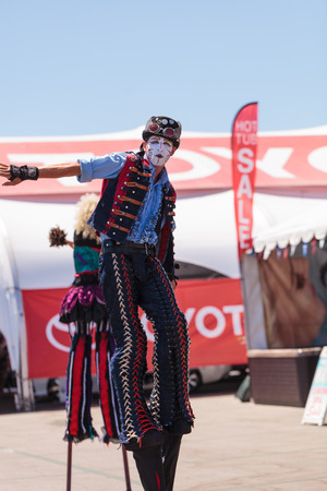 oc: Costa Mesa, California, United States - July 16, 2016: Performer Benjamin Gadbois with the Dragon Knights steampunk stilt walkers at the Orange County Fair in Costa Mesa, CA on July 16, 2016. Editorial use only.