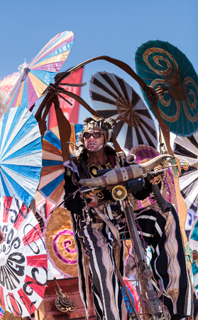 county fair: Costa Mesa, California, United States - July 16, 2016: Theatrical circus performer Derrick Gilday, part Mango and Dango, performs with Dragon Knights steampunk stilt walkers at the Orange County Fair in Costa Mesa, CA on July 16, 2016. Editorial use only.