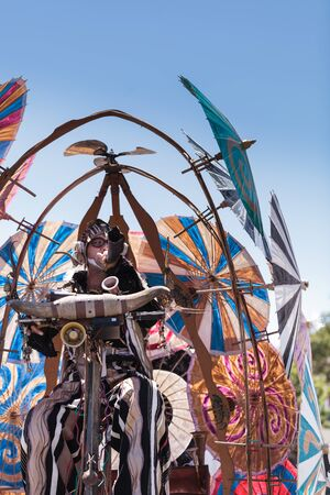 Costa Mesa, California, United States - July 16, 2016: Theatrical circus performer Derrick Gilday, part Mango and Dango, performs with Dragon Knights steampunk stilt walkers at the Orange County Fair in Costa Mesa, CA on July 16, 2016. Editorial use only.