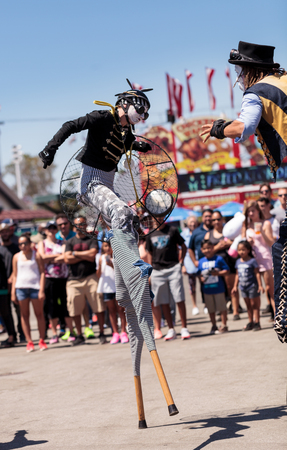 16: Costa Mesa, California, United States - July 16, 2016: Dragon Knights steampunk stilt walkers perform at the Orange County Fair in Costa Mesa, CA on July 16, 2016. Editorial use only.