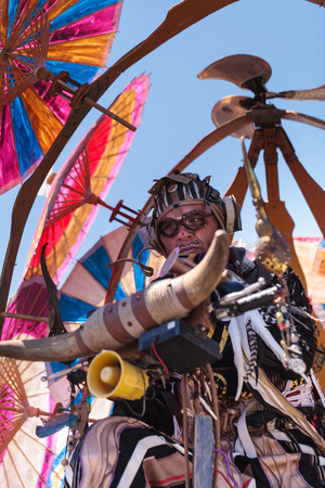 oc: Costa Mesa, California, United States - July 16, 2016: Theatrical circus performer Derrick Gilday, part Mango and Dango, performs with Dragon Knights steampunk stilt walkers at the Orange County Fair in Costa Mesa, CA on July 16, 2016. Editorial use only.