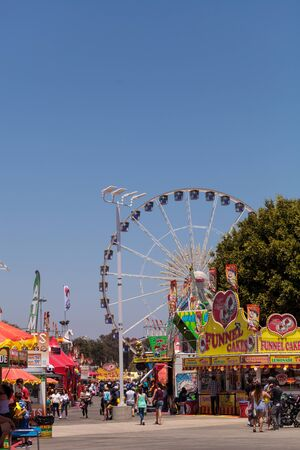 oc: Costa Mesa, California, United States - July 16, 2016: Ferris wheel at the Orange County Fair in Costa Mesa, CA on July 16, 2016. Editorial use only.