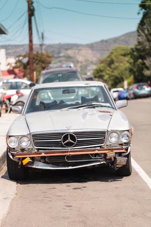 fixer upper: Laguna Beach, CA, USA – August 20, 2016: A run down classic Mercedes benz pagoda sports car on the street in Laguna Beach, California. Editorial use only.